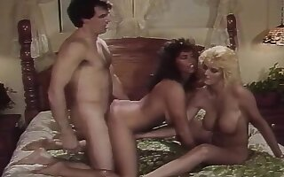 Classic porn threesome with two babes doing him and each other